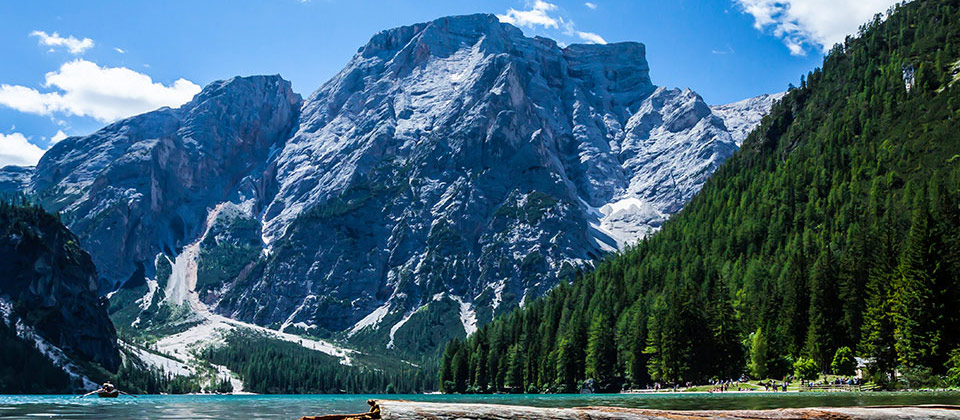Braies Lake in Val Pusteria in-between snowy mountains and woods